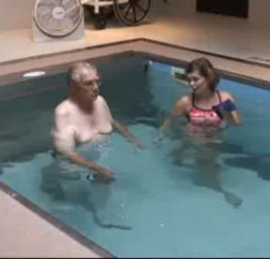 two people talking in a therapy pool