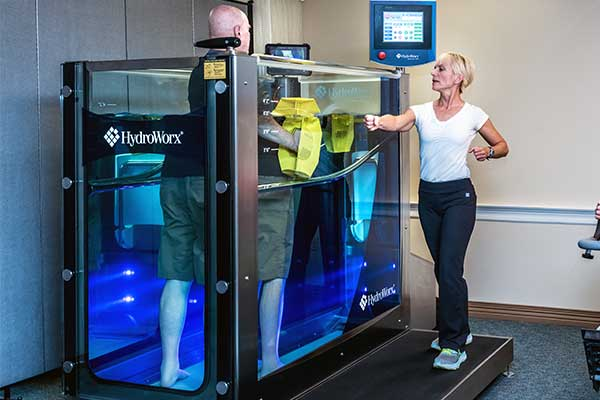 Person Using HydroWorx 300 with Trainer