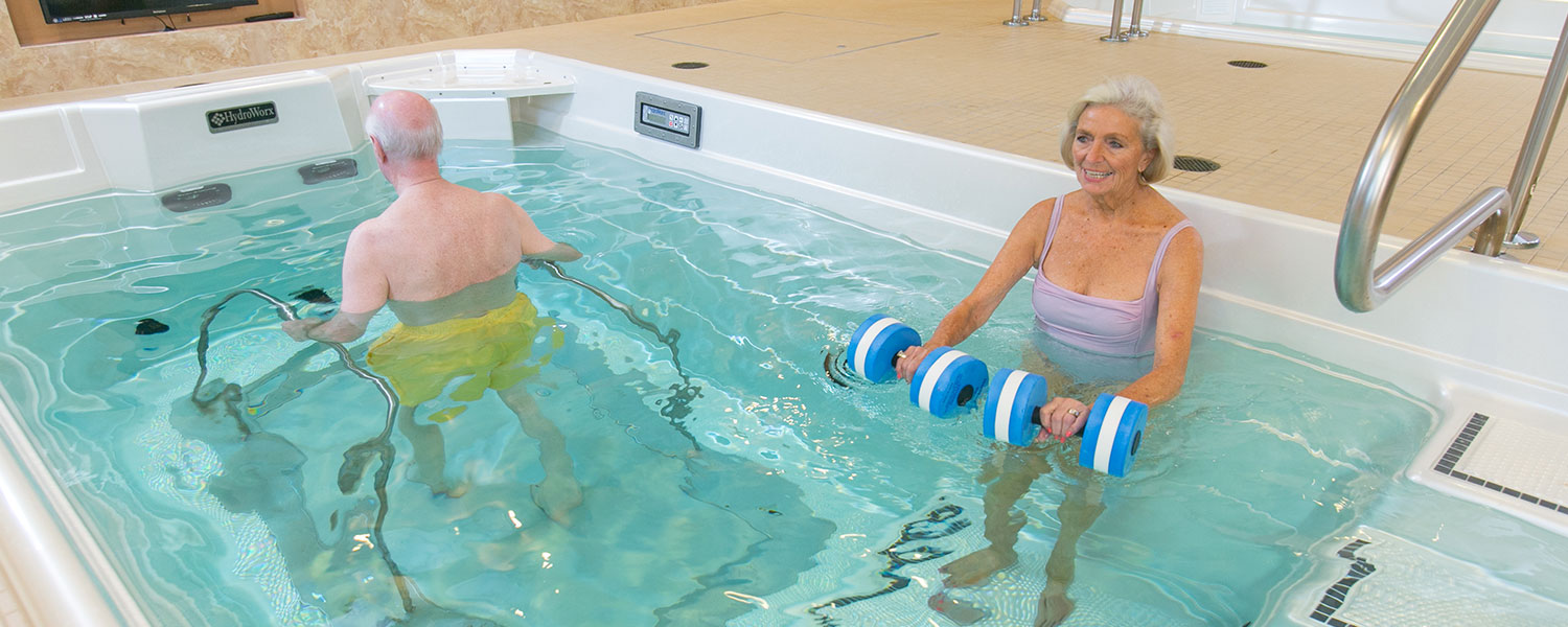 Two people training together in HydroWorx Pool