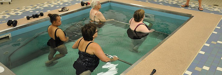 Group water therapy with trainer