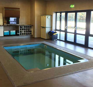Indoor HydroWorx pool by building exit